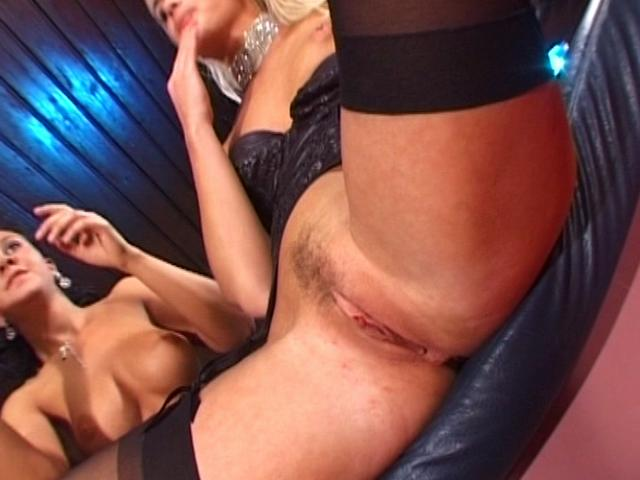 Corrupting blonde lesbian in stockings gets pussy dildoed by a hot brunette babe