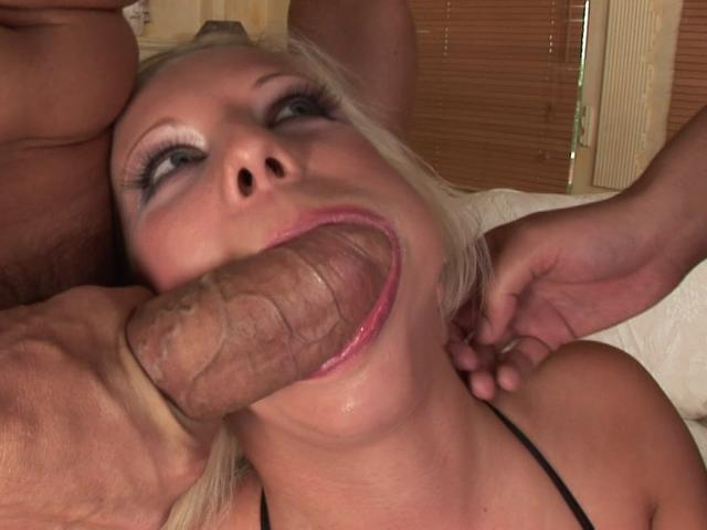 Corrupting blonde nymphet sucking two massive peckers on the couch