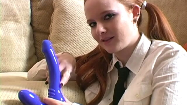 corrupting-redhead-teen-in-pigtails-halo-sucking-a-big-dildo-on-the-couch_01