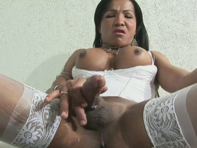 Dark skinned tranny with large tits Sabrina Washington wanks her enormous dick