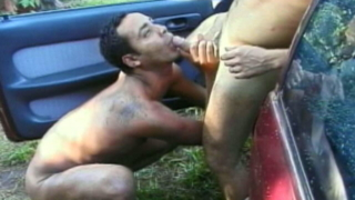 Dark skinned twink Wellington slurping Andre`s big penis on the car