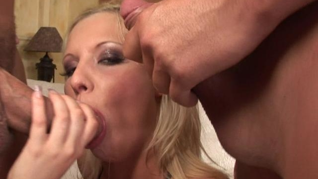 delicate-blonde-wench-slurping-two-giant-cocks-with-lust_01