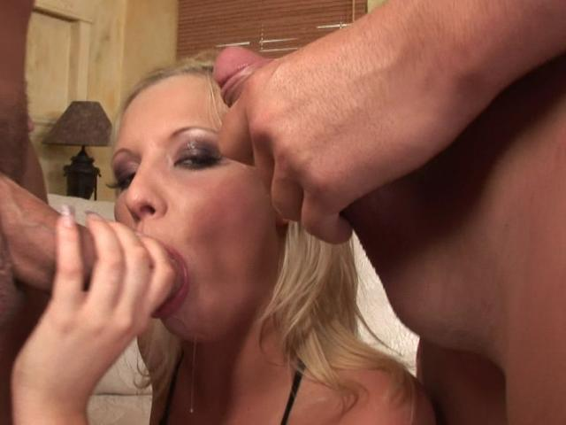 Delicate blonde wench slurping two giant cocks with lust