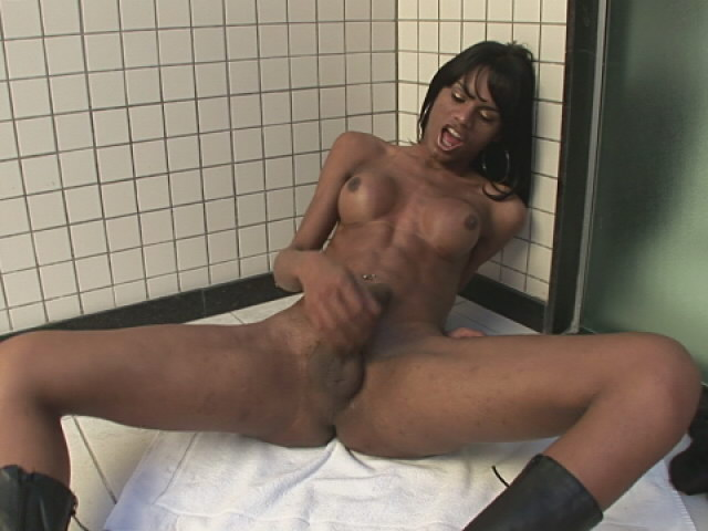 Enchanting brunette shemale with round tits Kawana showing her assets on the bathroom floor