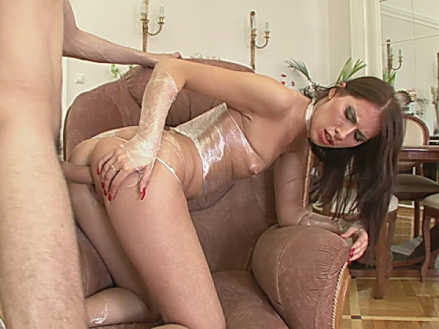 Enchanting brunette whore getting anally penetrated by a giant dong doggy style