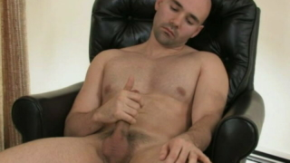 Enticing Bald Gay Bucky Rubbing His Enormous Shaft On The Armchair