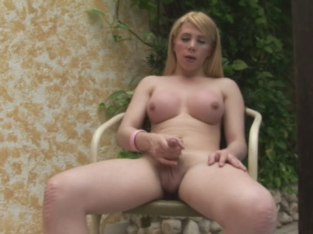 Enticing blonde tranny with big breasts Fabi Colt masturbating her cock on the chair Free Tranny Passport XXX Porn Tube Video Image