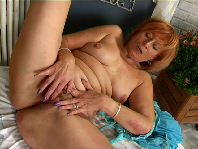 Enticing redhead granny Lady masturbating her hairy beaver hard