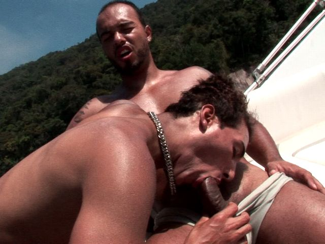Excited bronzed twink Alan sucking Matheus's huge dark cock on a boat