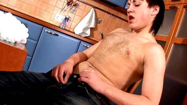 excited-brunette-gay-paul-stripping-and-wanking-his-hard-pecker-in-the-kitchen_01-1