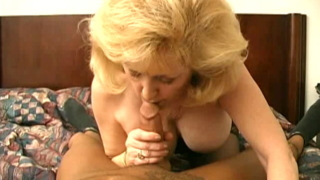 Excited busty blonde granny in black lingeria Kitty Fox slurps and licks a big cock with lust