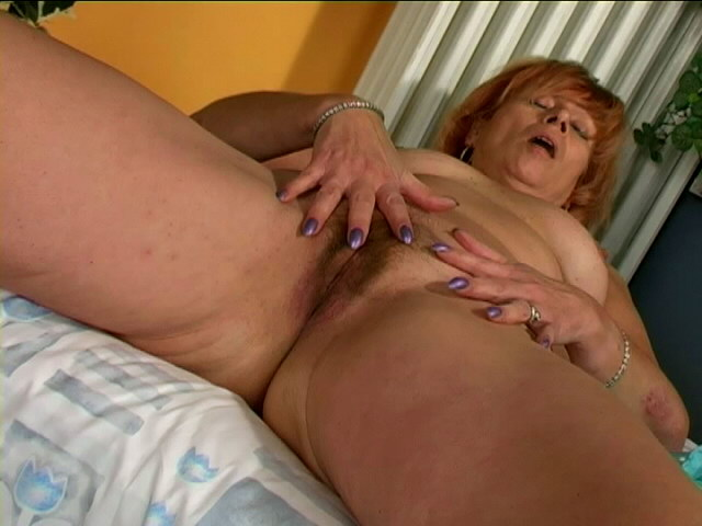 Excited granny Lady stripping blue panties and fingering her hairy snatch