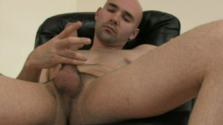 Fantastic Bald Gay Bucky Wanking His Gigantic Dick On The Armchair