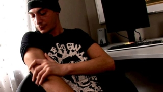 Fine lookig brunette gay Timo Hardy teasing us with his sexy black t-shirt