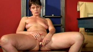 Fine looking brunette granny Marketa  sucking an enormous dildo with lust