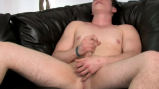 Fine Looking Gay Bruce Playing With His Shaved Balls And Hard Pecker On The Couch