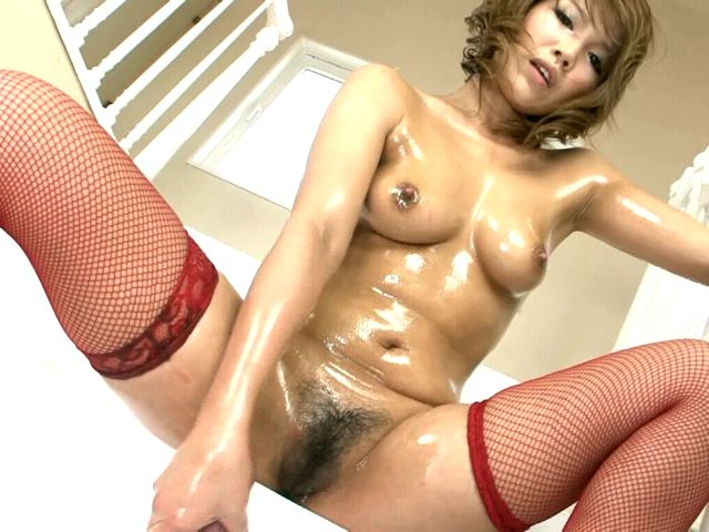 Fine looking Japan hottie Akiho Nishimura fucking her big oiled tits with a yellow dildo on camera Erotic Japan XXX Porn Tube Video Image