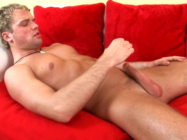 Firm bodied blonde gay rubbing his massive dong on the couch