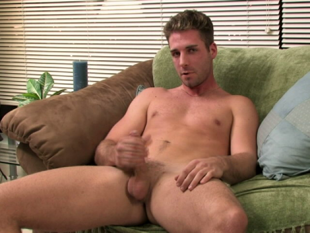Firm bodied gay Johnny wanking his monster phallus on the couch