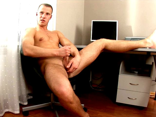 Firm bodied sexy gay Ken spreading legs on the desk and jerking off his huge cock for you