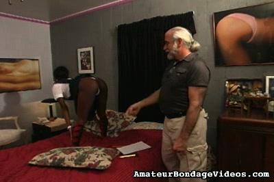 Flogging her black pussy