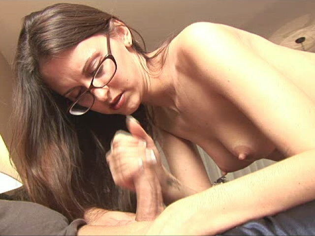 Geeky girl in glasses Nikki kissing and jerking a big schlong like a champ