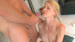 Ginger pets her clit when the stud fucks her.