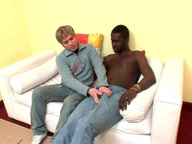 Good looking blond amateur gay Cristian playing with Canu's massive black dick on the couch