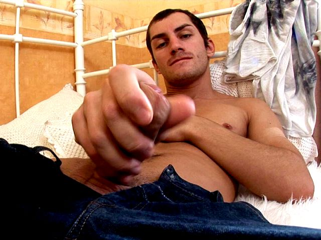 Good looking brunette gay Tommy masturbating his huge schlong on camera