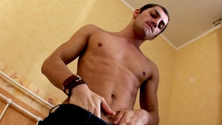 Good looking brunette Tommy stripping and exposing his perfect body and large penis