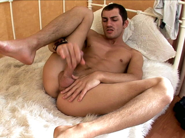 Good looking european twink wanking his gigantic pecker in bedroom