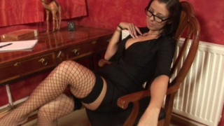 Good looking office babe in fishnets teasing us with her hot body