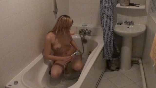 gorgeous-blonde-voyeur-cutie-marina-rub-wet-pussy-in-the-bath-tube-on-spy-camera_01-1