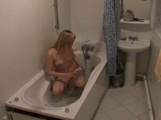 Gorgeous blonde voyeur cutie Marina rub wet pussy in the bath tube on spy camera