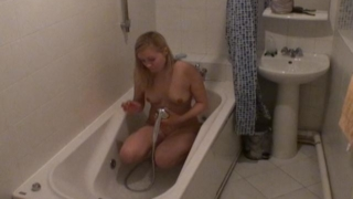 Gorgeous blonde voyeur cutie Marina rub wet pussy in the bath tube on spy camera