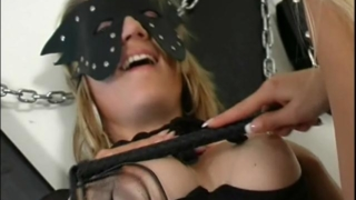 Gorgeous masked slave gets big tits spanked and pussy fingered by a mistress