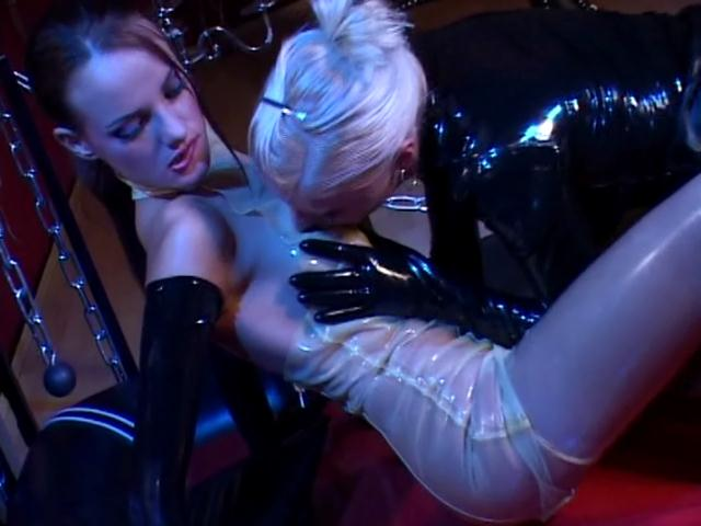Gorgeous slave in latex dress Sif Sebak gets body licked by a sexy blonde mistress