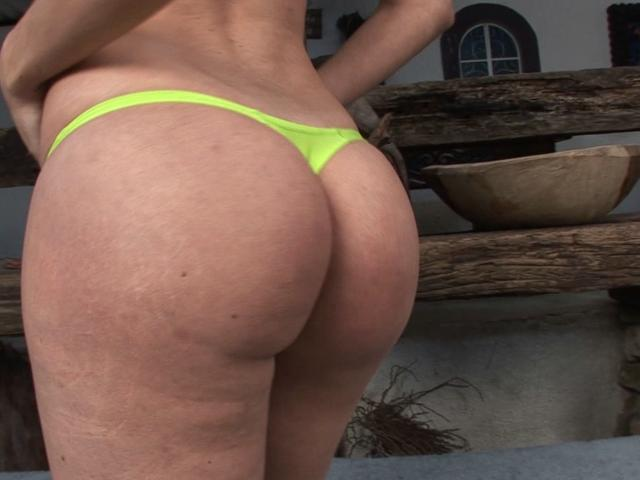 Gorgeous tranny Dani teasing us with her green bikini and bubble butt