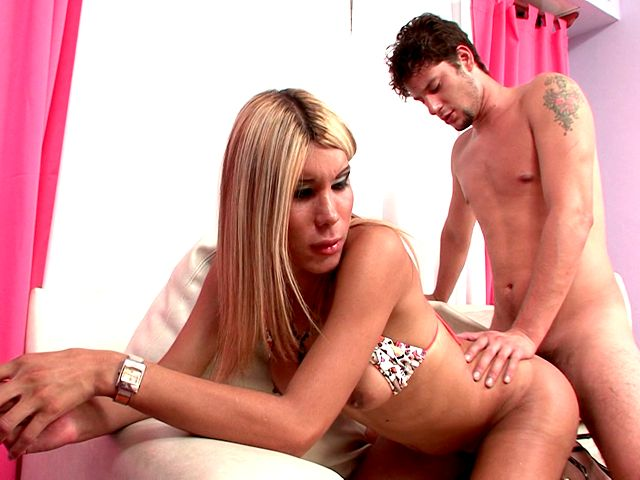 Graceful blonde shemale whore Melane gets butt fucked by a tattooed dude