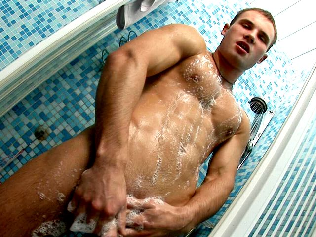 Hard muscled European twink Stefan washing his perfect body and cock in the shower