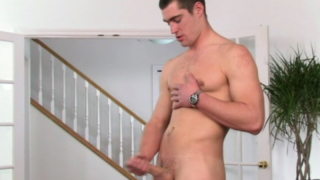 Hefty brunette gay Mike jerking his massive cock hard