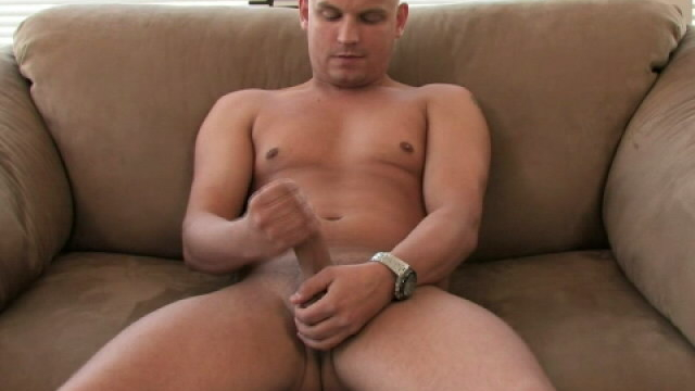 Horny-bald-gay-lance-masturbating-his-thick-cock-on-the-couch_01
