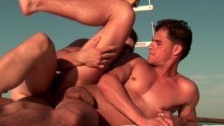 Horny bronzed gay Arcanjo riding anally Eduardo's huge schlong on a boat