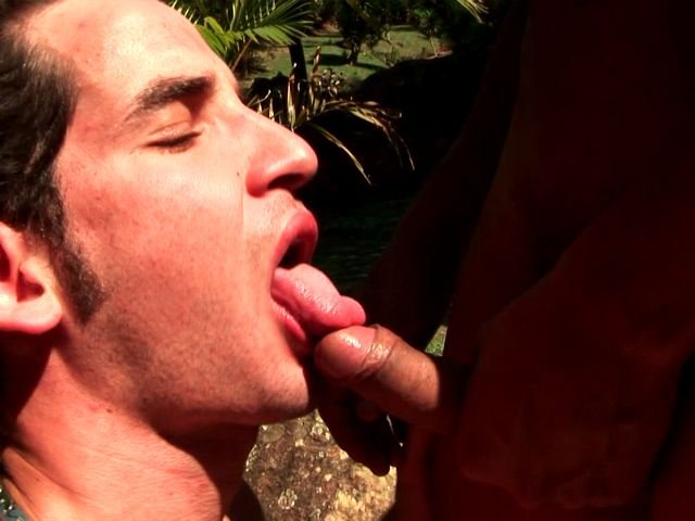Horny brunette amateur gay Andre licking Felix's shaft on his knees outdoors