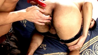 Horny gay Dmitry getting butt fucked with a large red dildo by horny Tommy