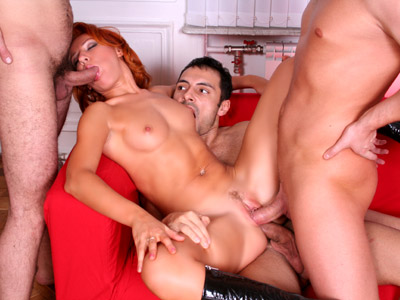 Horny girl accommodates two dicks graciously