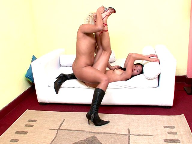 Horny shemale in boots Carolina screwing Maria's little snatch on the couch