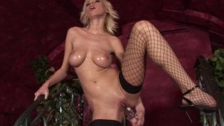 Hot blonde babe in fishnets fucking a giant glass dildo