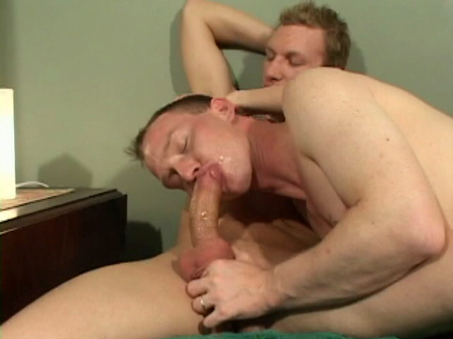 Hot blonde gay Adam slurping a gigantic penis in a threesome Impossible Gay Cocks XXX Porn Tube Video Image