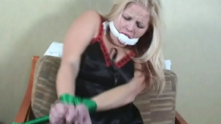 Hot blonde slave Debra gets tied up on the chair